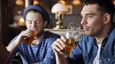 hat : people toast leisure friendship and celebration concept  happy male friends drinking beer and clinking glasses at bar or pub