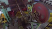 cyklus : agriculture, manufacture, industry and farming concept - vintage machine mechanism spinning at factory