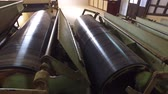 сельскохозяйственный : agriculture, manufacture, industry and farming concept - vintage machine conveyor rolls spinning at factory