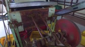 rodar : agriculture, manufacture, industry and farming concept - vintage machine mechanism spinning at factory