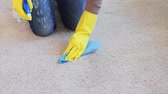 trapo : people, housework and housekeeping concept - woman in gloves cleaning carpet or rug with rag