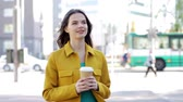одноразовый : drinks and people concept - happy young woman or teenage girl drinking coffee from paper cup on city street