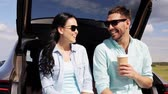 одноразовый : happy couple with coffee at hatchback car trunk 41