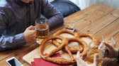 lanches : male friends drinking beer at bar or pub