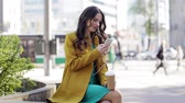 одноразовый : happy young woman with smartphone and headphones