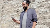 mensagem : man texting message on smartphone at stone wall 5 Vídeos