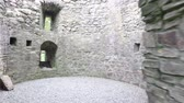 irlandês : medieval tower with arches and loopholes inside 55