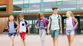 classmates : group of happy elementary school students walking Stock Footage