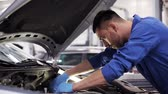 motor : mechanic man with wrench repairing car at workshop 9
