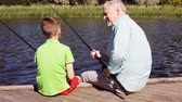vnuk : grandfather and grandson fishing on river berth 22