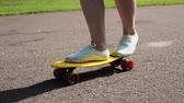 activities : teenage girl feet riding short modern skateboard