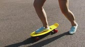 galhofeiro : teenage girl feet riding short modern skateboard