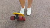 крейсер : teenage girl putting short modern skateboard down