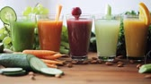 organic : glasses of juice, vegetables and fruits on table