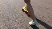 empurrando : teenage girl feet riding short modern skateboard