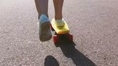 крейсер : teenage girl feet riding short modern skateboard