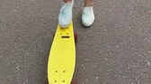 galhofeiro : teenage girl foot putting short skateboard on end