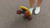 крейсер : teenage girl foot putting short skateboard on end