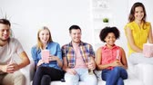 internacional : friends with popcorn and beer watching tv at home Stock Footage