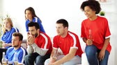 internacional : friends or football fans watching soccer at home
