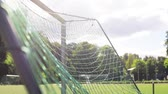 activities : ball flying into football goal net on field