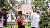 muzyka : happy friends dancing at summer party in garden Wideo