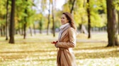 kurtka : beautiful young woman walking in autumn park