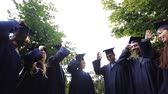 argamassa : happy students throwing mortar boards up