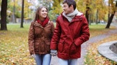 pěkný : happy young couple walking in autumn park