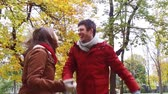 смех : happy young couple having fun in autumn park