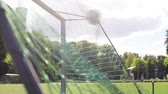 oynamak : ball flying into football goal net on field