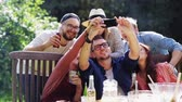 muitos : friends taking selfie at party in summer garden Vídeos
