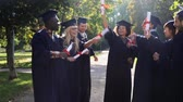 argamassa : happy students in mortar boards with diplomas