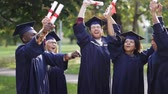 hat : happy students in mortar boards with diplomas
