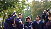 афроамериканца : happy students throwing mortar boards up