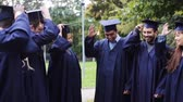 roucho : happy students throwing mortar boards up