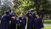 graduating : happy students throwing mortar boards up