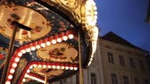 koń : illuminated carousel in old city at night