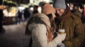 maravilhado : happy couple with coffee at christmas market