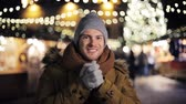 мода : happy man in hat and winter jacket at christmas