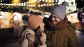 natal : happy couple hugging at christmas market