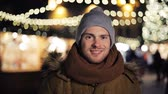 рынок : happy man in hat and winter jacket at christmas