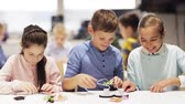 montagem : happy children learning at robotics school Stock Footage