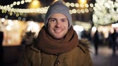 scarf : happy man in hat and winter jacket at christmas