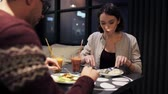 романтический : happy couple enjoying dinner at vegan restaurant
