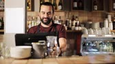 kitchen counter : happy man or waiter at cashbox in coffee shop Stock Footage