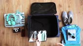 hands packing travel bag with personal stuff Stok Video