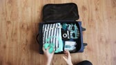 planlama : hands packing travel bag with personal stuff Stok Video