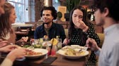 ресторан : happy friends eating and drinking at restaurant