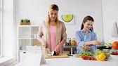 família : happy family cooking dinner at home kitchen